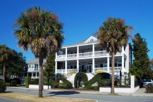 See? A southern home, what with its balconies and porches, being flanked by something out of South Pacific is weird.