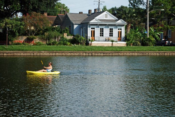 Away from the tourist infested center of the city some folks like to spend a few hours paddling in one of the cities many waters.